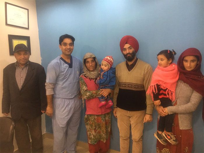 Doctor and patient happy picture after cleft surgery at TIPS Plastic surgery clinic